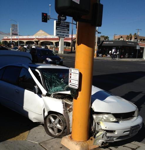 car plowed into a pole